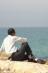 Я сижу на песочной земле